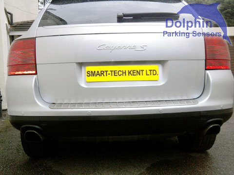 Porsche Cayenne bumper wit sensors installed in matching silver