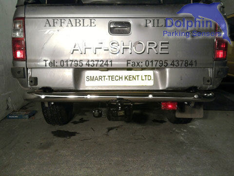 Ford ranger with silver rear sensors installed in chrome bumper