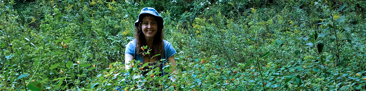 Karen Harvesting Jewelweed