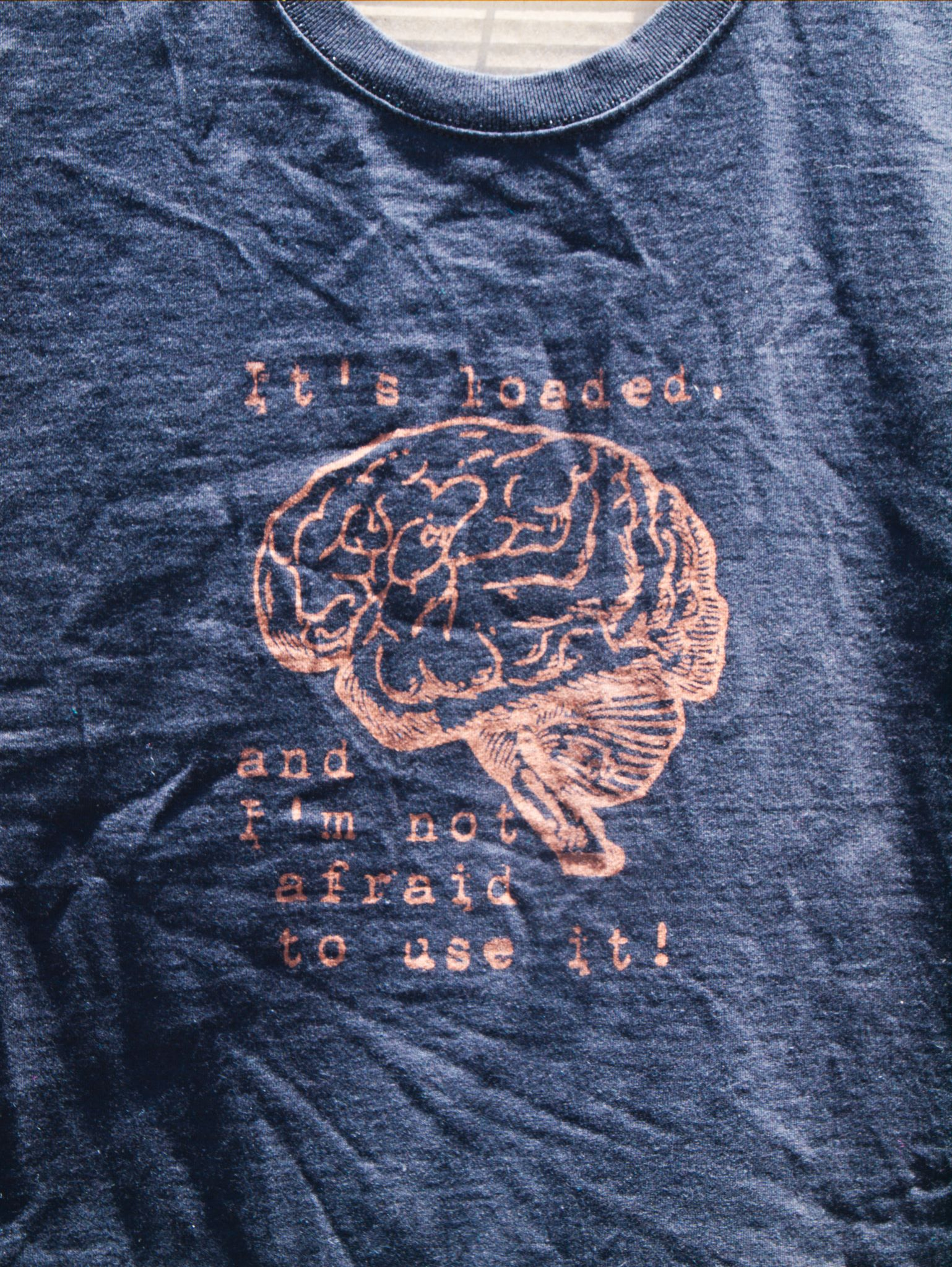 It's loaded and I'm not afraid to use it discharge tee shirt design with brain