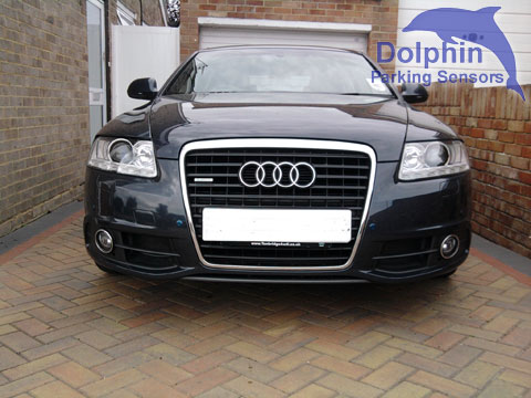 Black Audi a6 with parking sensors fitted in to the front bumper