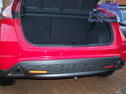 dolphin parking sensors installed on red honda civic