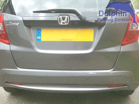 Iron grey parking sensors installed on to a Honda Jazz