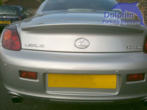 Lexus SC430 with silver parking sensors installed