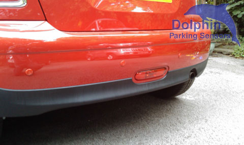 red parking sensor installed in body coloured bumper of Mini One