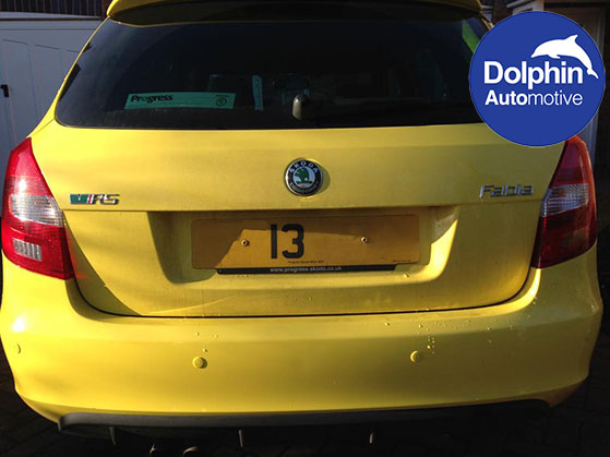 Yellow Skoda parking sensors