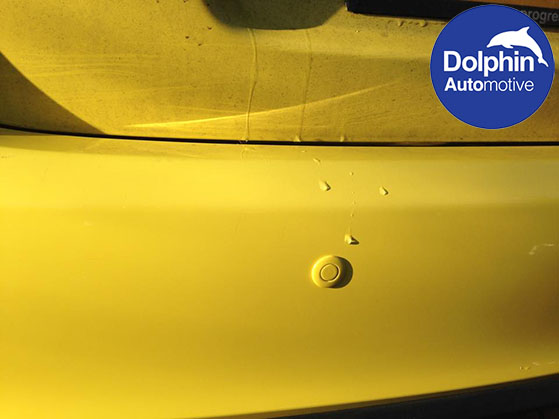 close up of yellow parking sensors
