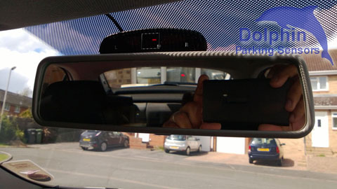 display installed on top of the rear view mirror