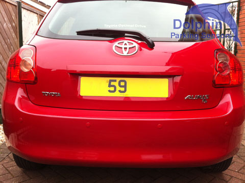 Red Toyota Auris with matching parking sensors